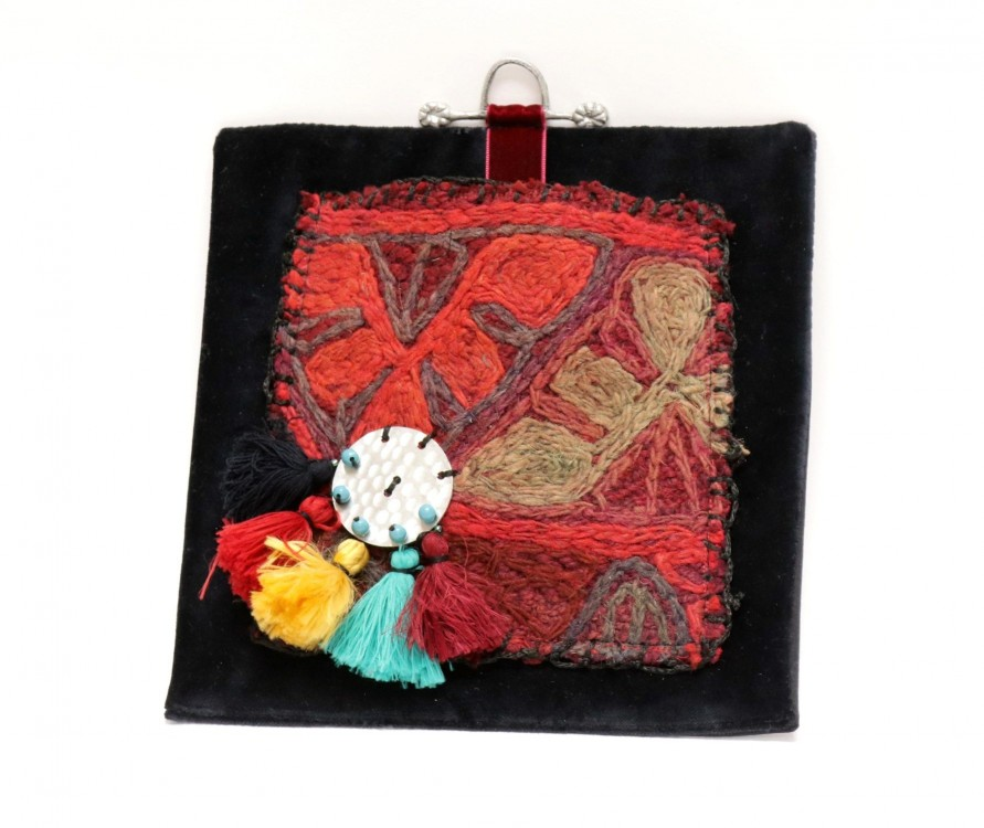 Lucky Charm in Weaving Fabric with Pompoms on Black Velvet Background